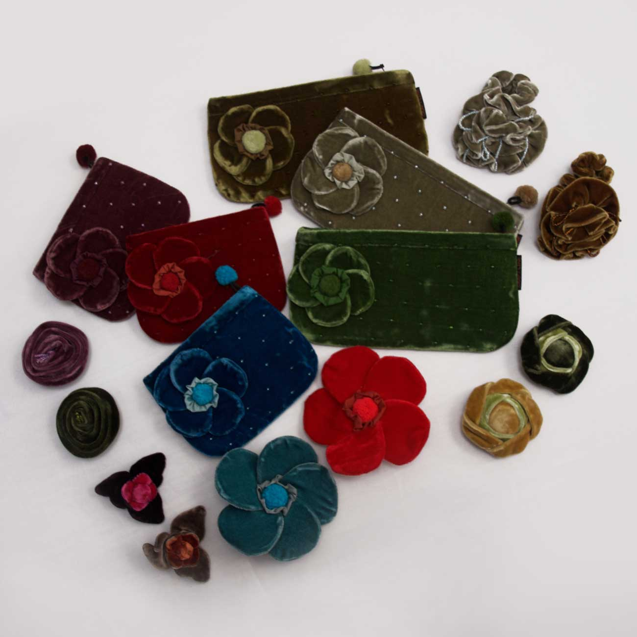 Velt brooches and purses