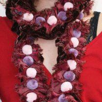 Velvet scarf with small pompoms