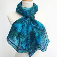 Silk-scarf-in-rich-blues-with-dogs